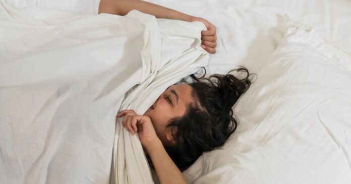 Move Around A Lot In Your Sleep? Here's What It Really Means